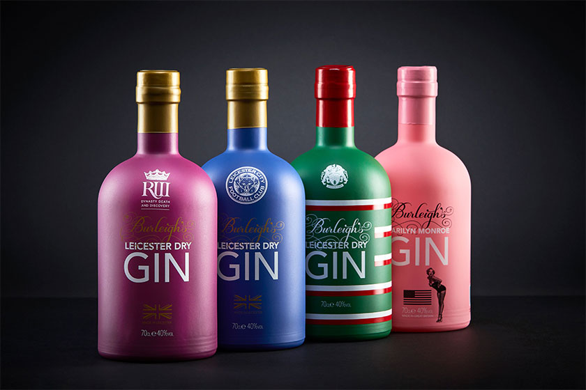 four bottles of Gin product shown