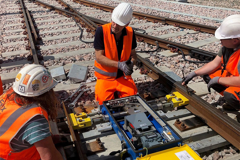 image depicts working on railway track