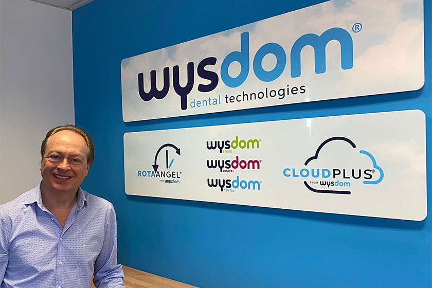 founder of business stood in front of Wysdom sign
